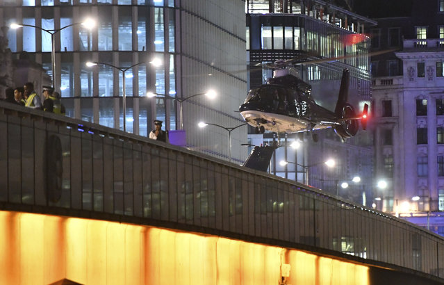 An helicopter lands on London Bridge after an attack in central London, Saturday, June 3, 2017. Armed British police rushed to London Bridge late Saturday after reports of a vehicle running down pedestrians and people being stabbed nearby. (Photo by Dominic Lipinski/PA Wire via AP Photo)