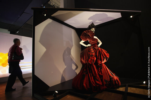 A dress designed by British designer Alexander McQueen stands on display at the Victoria and Albert museums' new major exhibition