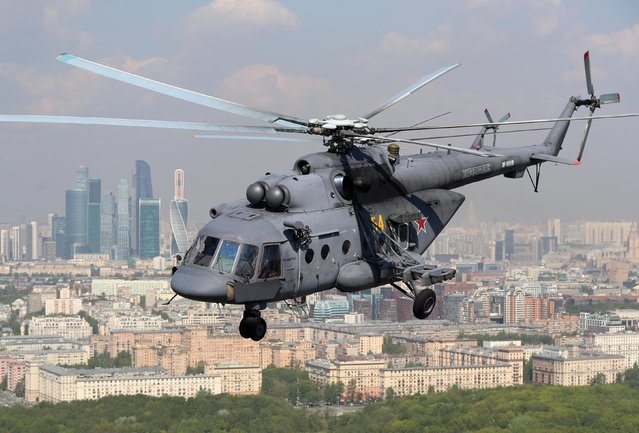 Mil Mi-8 combat helicopter flies over Moscow, Russia on May 7, 2019 during the dress rehearsal of a Victory Day air show marking the 74th anniversary of the victory over Nazi Germany in the 1941-1945 Great Patriotic War, the Eastern Front of World War II. (Photo by Sergei Savostyanov/TASS)