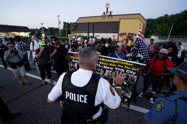 Police ask protesters to stay off the street in Ferguson, Missouri, August 10, 2015. (Photo by Rick Wilking/Reuters)