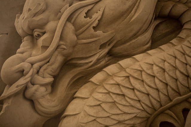 A large dragon sand sculpture is seen at the site of Yokohama Sand Art Exhibition – Culture City of East Asia 2014 on July 16, 2014 in Yokohama, Japan. Producer and sand sculptor Katsuhiko Chaen invited artists from around the world including South Korea and China, to recreate the World Heritage and historical buildings in China, Japan and South Korea. The exhibition will be open from July 19 to November 3, 2014. (Photo by Chris McGrath/Getty Images)