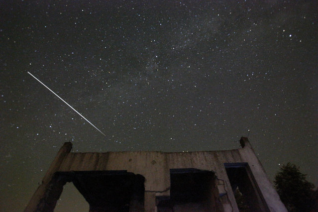 Stars and meteor streaks are seen behind a destroyed house, near Tuzla, Bosnia, Wednesday, August 12, 2015. The annual Perseid meteor shower reaches its peak on Wednesday night. (Photo by Amel Emric/AP Photo)