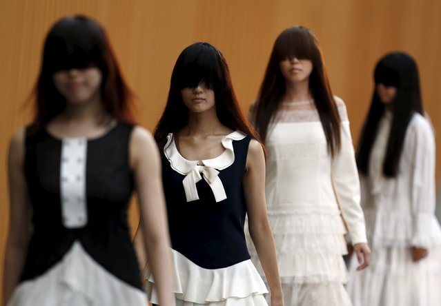 Models present creations of fashion brand motonari ono during Tokyo Fantashion at a shopping district in Tokyo, Japan, August 16, 2015. (Photo by Yuya Shino/Reuters)