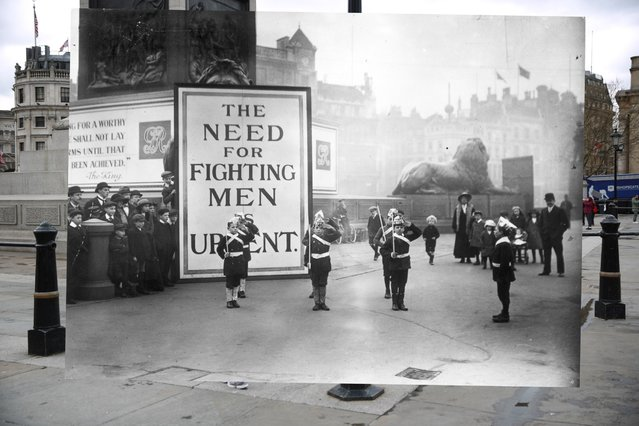 "People stand at Trafalgar Square on March 17, 2014 in London, England. In Trafalgar Square, London street urchins dressed as soldiers with paper hats and canes as guns stand to attention watched by a small crowd. Behind them is a notice declaring ""The Need for Fighting Men is Urgent"", November, 1914. (Photo by Peter Macdiarmid/Getty Images)"