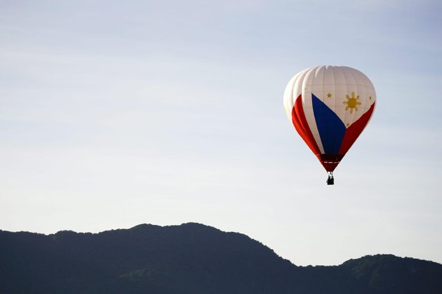 A hot air balloon from the Philippines floats in the air during the 2016 International Hot Air Balloon Festival in Taitung, southeast of Taiwan, 01 July 2016. (Photo by Ritchie B. Tongo/EPA)