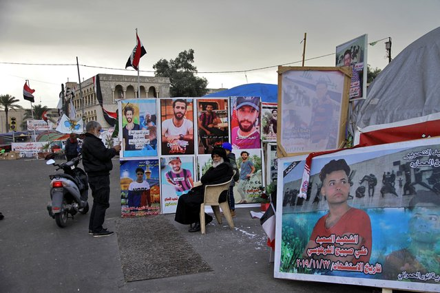Posters of anti-government protesters who have been killed in demonstrations are displayed in Tahrir Square during ongoing protests in Baghdad, Iraq, Wednesday, January 8, 2020. (Photo by Khalid Mohammed/AP Photo)