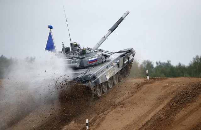 A tank drives on the course of the Tank Biathlon world championship in Alabino outside Moscow August 16, 2014. (Photo by Maxim Zmeyev/Reuters)