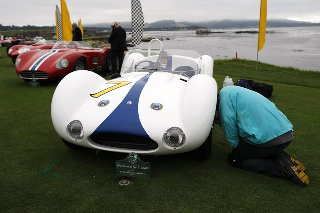 A 1960 Maserati Tipo 61 Spyder is prepared for the Concours d'Elegance on the 18th fairway of the Pebble Beach Golf Links in Pebble Beach, California, August 17, 2014. (Photo by Michael Fiala/Reuters)