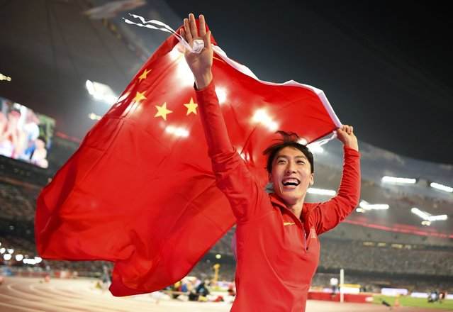 Second placed Lyu Huihui of China celebrates with a national flag after winning silver in the women's javelin throw final during the 15th IAAF World Championships at the National Stadium in Beijing, China, August 30, 2015. (Photo by Dylan Martinez/Reuters)