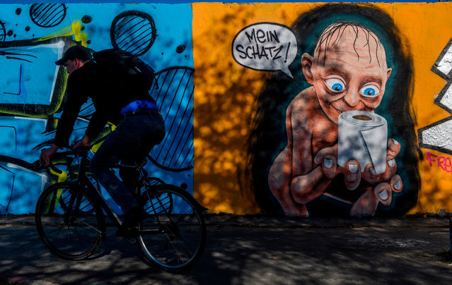 A mural by graffiti artist Eme Freethinker depicting Gollum from Lord of the Rings worshipping a toilet roll, in Mauerpark, Berlin, Germany on March 23, 2020. (Photo by John MacDougall/AFP Photo)