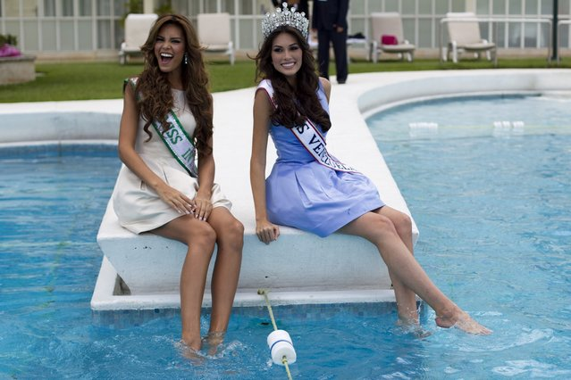 Miss Venezuela 2012 Maria Isler (R) and the first runner up Elian Herrera pose for the media after a news conference in Caracas August 31, 2012. Isler will represent the country in the 2013 Miss Universe pageant. (Photo by Carlos Garcia Rawlins/Reuters)