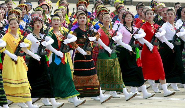 Female members of ethnic minorities militia force march during a parade marking their 70th National Day at Ba Dinh square in Hanoi, Vietnam September 2, 2015. (Photo by Reuters/Kham)