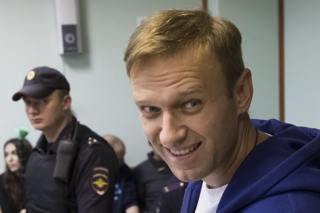 Russian opposition leader Alexei Navalny smiles as he speaks to the media during a break in the hearing on his appeal in a court in Moscow, Russia, Friday, October 6, 2017. The Moscow City Court on Friday upheld a 20-day jail term for Navalny for calling for an unsanctioned protest. (Photo by Pavel Golovkin/AP Photo)