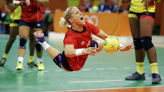 Norway's Heidi Loke is fouled by Angola's Luisa Kiala during the women's preliminary handball match at the 2016 Summer Olympics in Rio de Janeiro, Brazil, Wednesday, August 10, 2016. (Photo by Matthias Schrader/AP Photo)