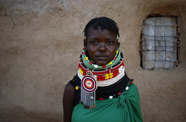 A Turkana woman stands by a hut in Napak village in northwestern Kenya inside the Turkana region of the Ilemy Triangle September 25, 2014. The Ilemi Triangle is a disputed region in East Africa, claimed by South Sudan and Kenya, bordering also Ethiopia. The dispute arose from unclear wording of a 1914 treaty which tried to allow free movement of the Turkana people, nomadic herders who had traditionally grazed the area. (Photo by Goran Tomasevic/Reuters)