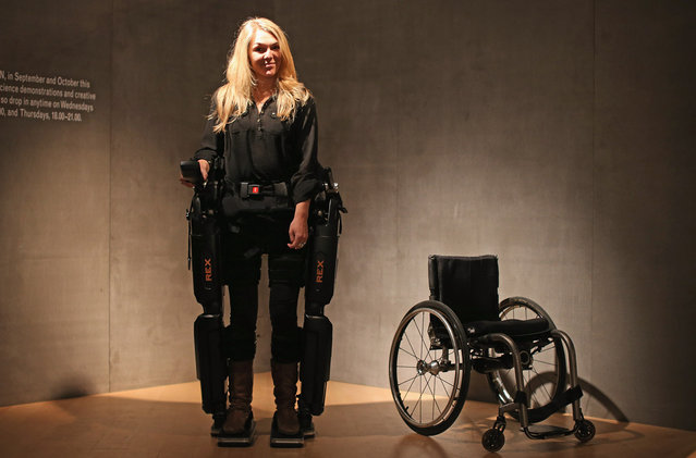 "Sophie Morgan walks with the aid of ""Rex"", a Robotic Exoskeleton at the Welcome Trust on September 19, 2012 in London, England. The system allows wheelchair users including fully paralyzed people, to stand upright and walk independently. Sophie was paralyzed from the breast bone down in 2003 following a car accident. (Photo by Dan Kitwood)"