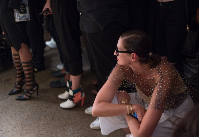 Creative director and president for J.Crew Jenna Lyons kneels as she looks on as the Chromat 2016 Spring collection is modeled during Fashion Week Friday, September 11, 2015, in New York. (Photo by Bryan R. Smith/AP Photo)