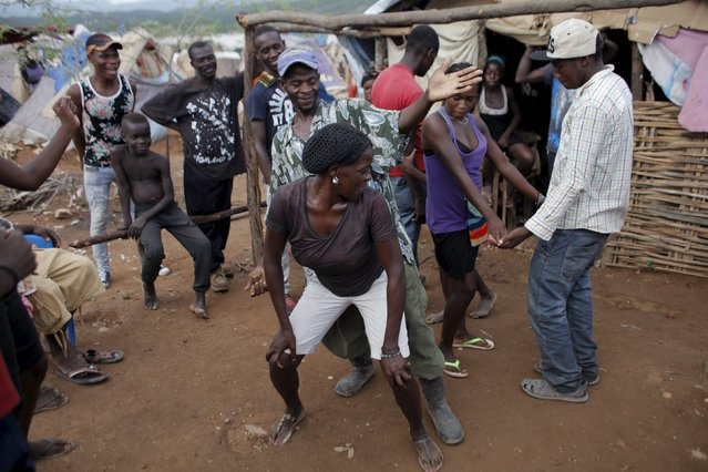 People enjoy themselves as they dance to Dominican music at a refugee camp for Haitians returning from the Dominican Republic on the outskirts of Anse-a-Pitres, Haiti, September 6, 2015. (Photo by Andres Martinez Casares/Reuters)