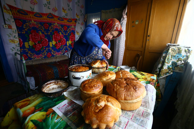 Yulia Panchenya, 82, makes Easter cakes on the eve of Orthodox Easter in Pogost, Belarus. (Photo by Vasily Fedosenko/Reuters)