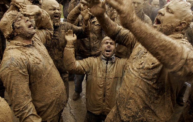 Mourners chant slogans as they cover themselves with mud during Ashoura rituals, marking the anniversary of the death of Imam Hussein, the grandson of Islam's Prophet Muhammad, in Bijar, west of Tehran, Iran, November 25, 2012. Hussein, one of Shiite Islam's most beloved saints, was killed in a 7th century battle at Karbala, Iraq. (Photo by Vahid Salemi/Associated Press)