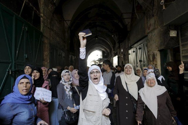 A Palestinian woman shouts slogans as she holds a Koran during clashes with Israeli police forces in Jerusalem's Old City September 28, 2015. (Photo by Ammar Awad/Reuters)