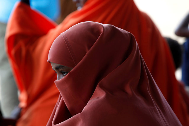 A Somali refugee waits to board a UN plane bound for Somalia, part of the UN's Voluntary Repatriation programme, in the Dadaab refugee camp, Kenya December 19, 2017. (Photo by Baz Ratner/Reuters)