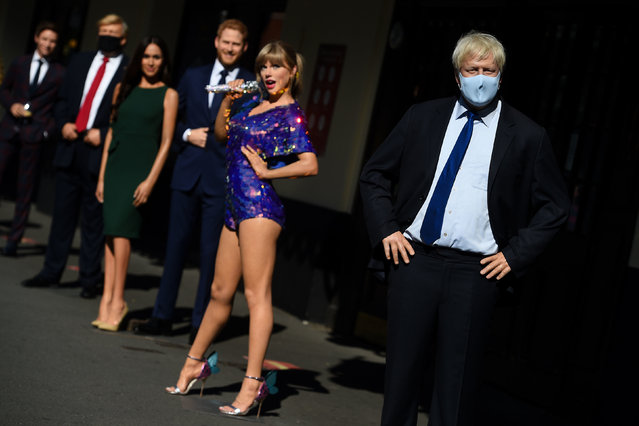 Wax figures, including Prime Minister Boris Johnson, US President Donald Trump and Taylor Swift, in the entrance line at Madame Tussaud's in London on July 30, 2020, as the attraction prepares to reopen to the public following the easing of lockdown restrictions in England. (Photo by Kirsty O'Connor/PA Images via Getty Images)