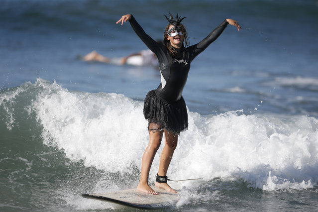 Cassidy Hallerstein, 13 rides a wave during the 7th annual ZJ Boarding House Haunted Heats Halloween surf contest. (Photo by Lucy Nicholson/Reuters)
