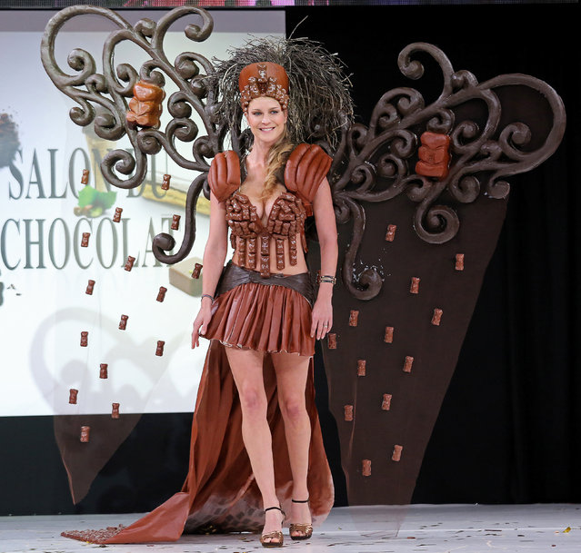 A model wears a creation made with chocolate during a fashion show at the inauguration of the 20th annual Salon du Chocolat in Paris on October 28, 2014. (Photo by David Silpa/UPI)