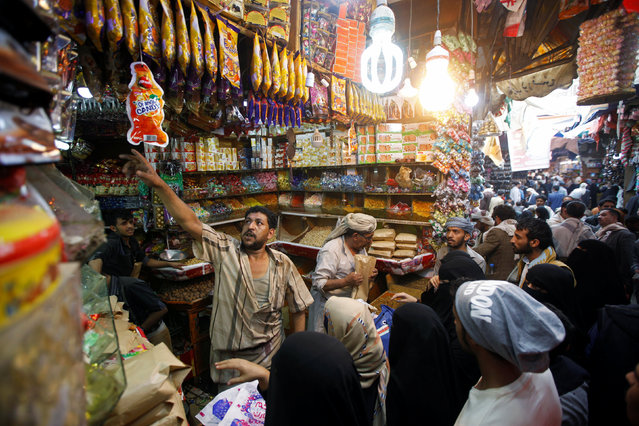 People buy sweets on the eve of the Eid al-Adha festival in Sanaa, Yemen September 11, 2016. (Photo by Mohamed al-Sayaghi/Reuters)