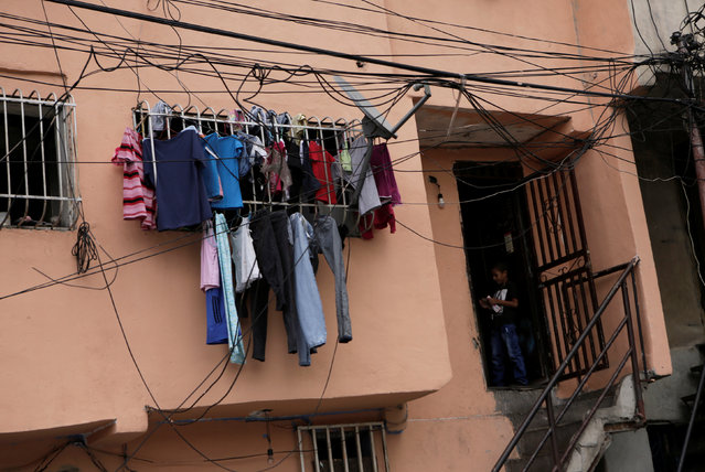 Clothes hang outside a window of a building to dry in Caracas, Venezuela September 8, 2016. (Photo by Henry Romero/Reuters)