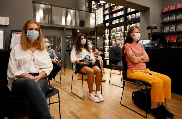 People wearing face masks and sitting observing social distancing among the 12 attendees as part of sanitary measures over the Covid-19 (novel coronavirus) pandemic, attend a literary evening in Zagreb on September 9, 2020. Croatia faces a rise in coronavirus infections after summer, during which they opened borders to tourists. (Photo by Denis Lovrovic/AFP Photo)