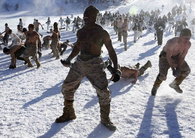 """South Korean and U.S. marines participate in a winter military drill in Pyeongchang, about 180 km (112 miles) east of Seoul February 7, 2013. North Korea has vowed to conduct more rocket and nuclear tests in response to a U.N. censure for its launch of a long-range missile launch in December. On Tuesday, it vowed """"stronger"""" but unspecified actions in addition to the test. (Photo by Lee Jae-Won/Reuters)"""