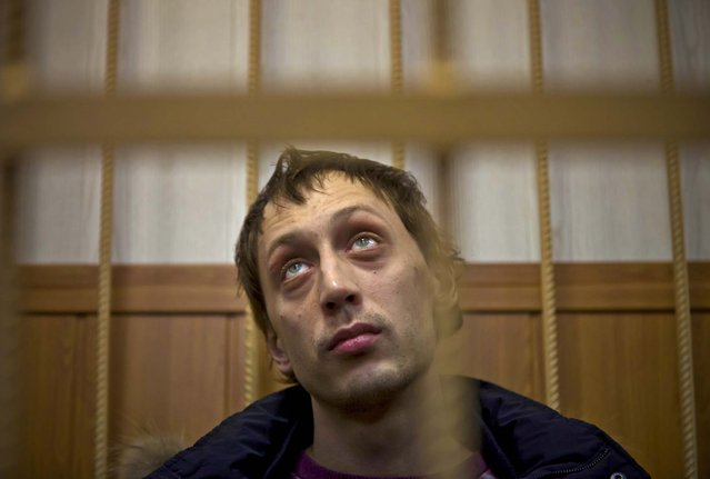 Bolshoi soloist Pavel Dmitrichenko appears in courtroom in Moscow, Russia, on March 7, 2013. The star dancer is accused of planning the attack on the Bolshoi ballet chief Sergei Filin and admitted that he gave the go-ahead for the attack, but said he did not order anyone to throw acid on the artistic director's face. (Photo by Alexander Zemlianichenko/Associated Press)