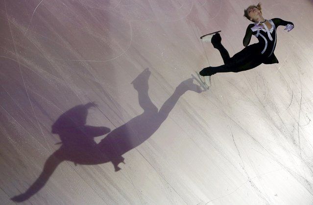A shadow is cast on the ice as Julia Lipnitskaia of Russia performs during the gala exhibition at the ISU Bompard Trophy Figure Skating event in Bordeaux, southwestern France, November 23, 2014. (Photo by Regis Duvignau/Reuters)