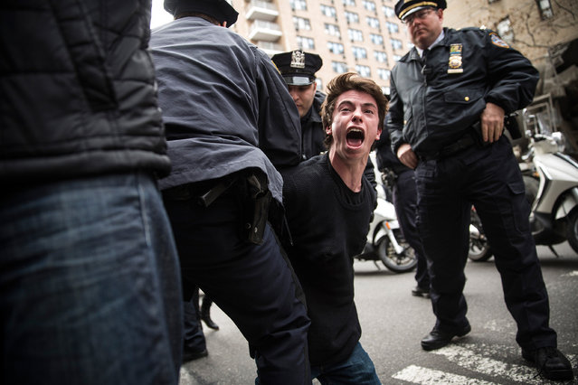 A man protesting the Ferguson grand jury decision to not indict officer Darren Wilson in the Michael Brown case is arrested while marching through the streets on December 1, 2014 in New York City. Brown, an 18-year-old black man, was killed by Darren Wilson, a white Ferguson, MO police officer, on August 9. (Photo by Andrew Burton/Getty Images)