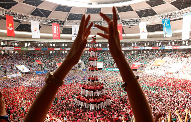 """Colla Vella Xiquets de Valls form a human tower called """"castell"""" during a biannual competition in Tarragona city, Spain, October 2, 2016. (Photo by Albert Gea/Reuters)"""