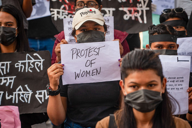 Youth activists wearing facemasks are seen holding placards during the protest against rape in Kathmandu on October 17, 2020. Youth activists take to the streets of Kathmandu to protest against the increasing number of rape cases in Nepal. The incidence of rape has been increasing over the years with the previous fiscal year 2019/20 recording 2,144 cases of rape and 687 cases of rape attempt where most victims were minor girls. (Photo by Sujan Shrestha/SOPA Images/LightRocket via Getty Images)