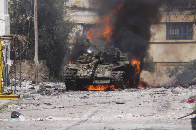 A burning tank is in Daraa, on March 9, 2013. (Photo by Ali Abu-Salah/Reuters/Shaam News Network /The Atlantic)