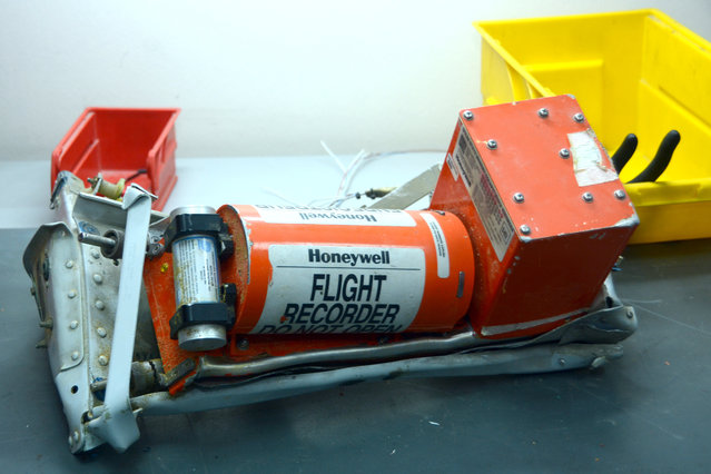 In this Russian Emergency Situations Ministry photo, made available on Monday, November 2, 2015, showing Metrojet Airbus A321-200 flight #7K9268 flight recorder in seen on display at an undisclosed location in Egypt, on Sunday, Nov. 1, 2015.  A Russian cargo plane on Monday brought the first bodies of Russian victims home to St. Petersburg, from the crash site in Egypt. (Photo by Russian Ministry for Emergency Situations photo via AP Photo)