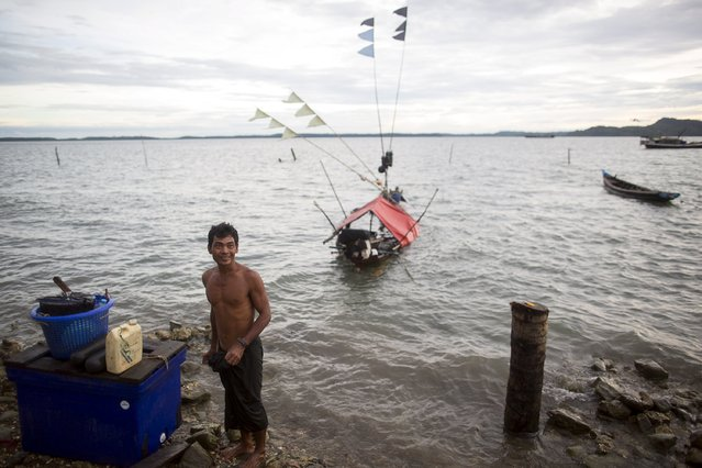 A fisherman prepares to fish with his small boat in Kyaukpyu township, Rakhine state, Myanmar October 6, 2015. (Photo by Soe Zeya Tun/Reuters)