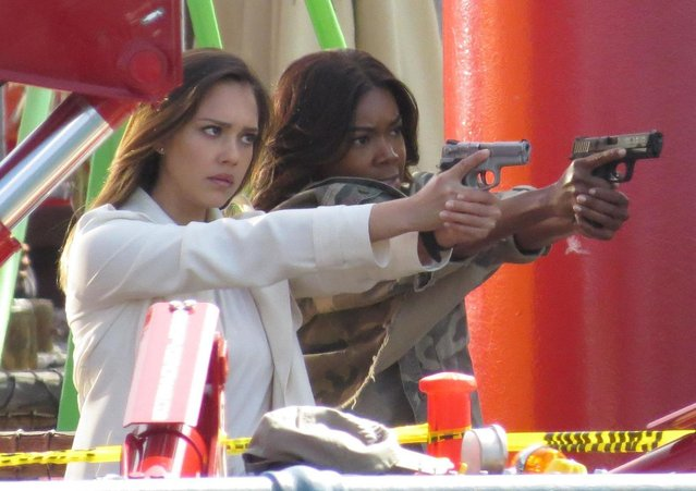 Jessica Alba and Gabrielle Union are gun toting bad asses on the set of their new Bad Boys spin off TV show as the pair film action scenes at the landmark Santa Monica Pier. Los Angeles, California, Tuesday April 3, 2018. (Photo by PacificCoastNews)