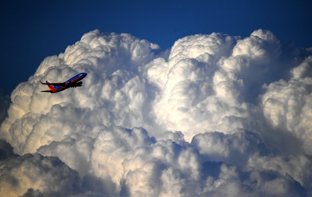A Southwest Airlines jet takes off from Reagan National  Airport with a thunderhead to the east on June 20, 2017 in Alexandria, VA. (Photo by Jonathan Newton/The Washington Post)