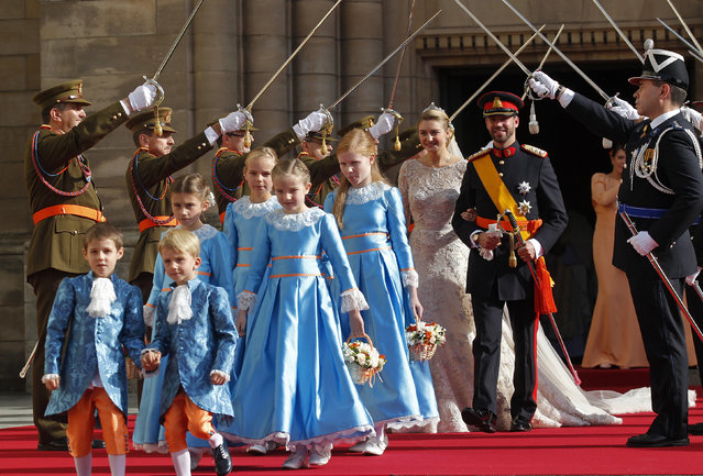 Luxembourg's Hereditary Grand Duke Guillaume and his wife Princess Stephanie, Hereditary Grand Duchess of Luxembourg, leave the Notre-Dame Cathedral after their religious wedding service in Luxembourg, October 20, 2012. (Photo by Vincent Kessler/Reuters)