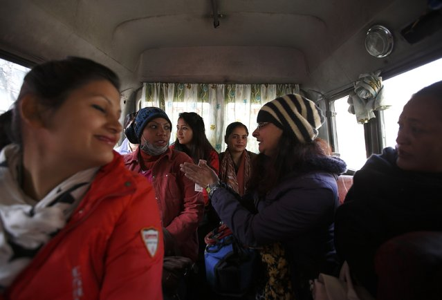 Passengers speak with each other as they travel in a women-only bus in Kathmandu January 6, 2015. (Photo by Navesh Chitrakar/Reuters)