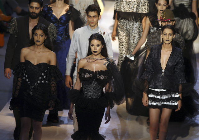 Models exhibit creations by Tunisian designer Achref Bacouche during the Tunis Fashion Week 2018 in Tunis, Tunisia, 12 May 2018. (Photo by Mohamed Messara/EPA/EFE)