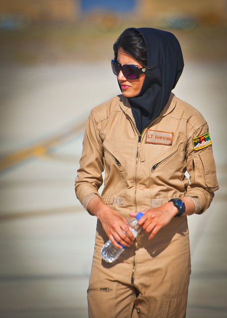 Afghan air force 2nd Lt. Niloofar Rhmani walks the flight line at Shindand Air Base, Afghanistan, prior to her graduation from undergraduate pilot training, on May 13, 2013. Rhmani made history on May 14, when she became the first female to successfully complete undergraduate pilot training and earn the status of pilot in more than 30 years. She will continue her service as she joins the Kabul Air Wing as a Cessna 208 pilot. (Photo by Senior Airman Scott Saldukas/USAF)