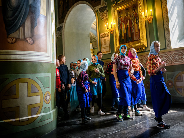 A group of school children visits a church in the Kremlin in the Russian city of Kazan on May 15, 2018. Kazan will host four group games, a Round of 16 match and a quarter-final of the 2018 FIFA World Cup. (Photo by Mladen Antonov/AFP Photo)