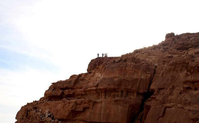 Hikers are seen on top of the Naqba Rum area in South Sinai, Egypt, November 20, 2015. (Photo by Asmaa Waguih/Reuters)