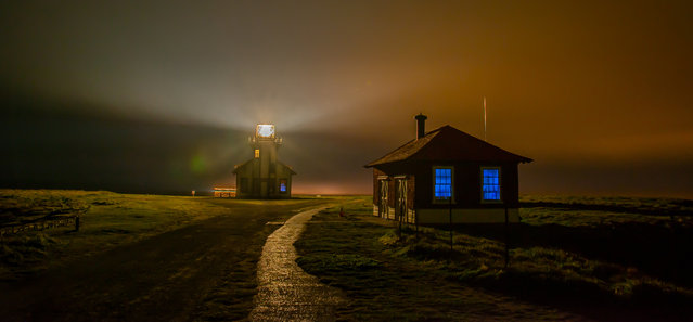 """Foggy Night at Point Cabrillo Light Station "". Photo taken on a very foggy night at Point Cabrillo, near Mendocino, California. The old blacksmith building could only be seen when hit by the light of the lighthouse. (Photo and caption by Melissa Loeffler/National Geographic Traveler Photo Contest)"